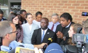 Montravias King speaks, surrounded by supporters from SCSJ, Democracy NC, the NC NAACP, and Rock the Vote.