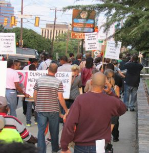 FADE coalition members march through downtown Durham on 9/16/13.